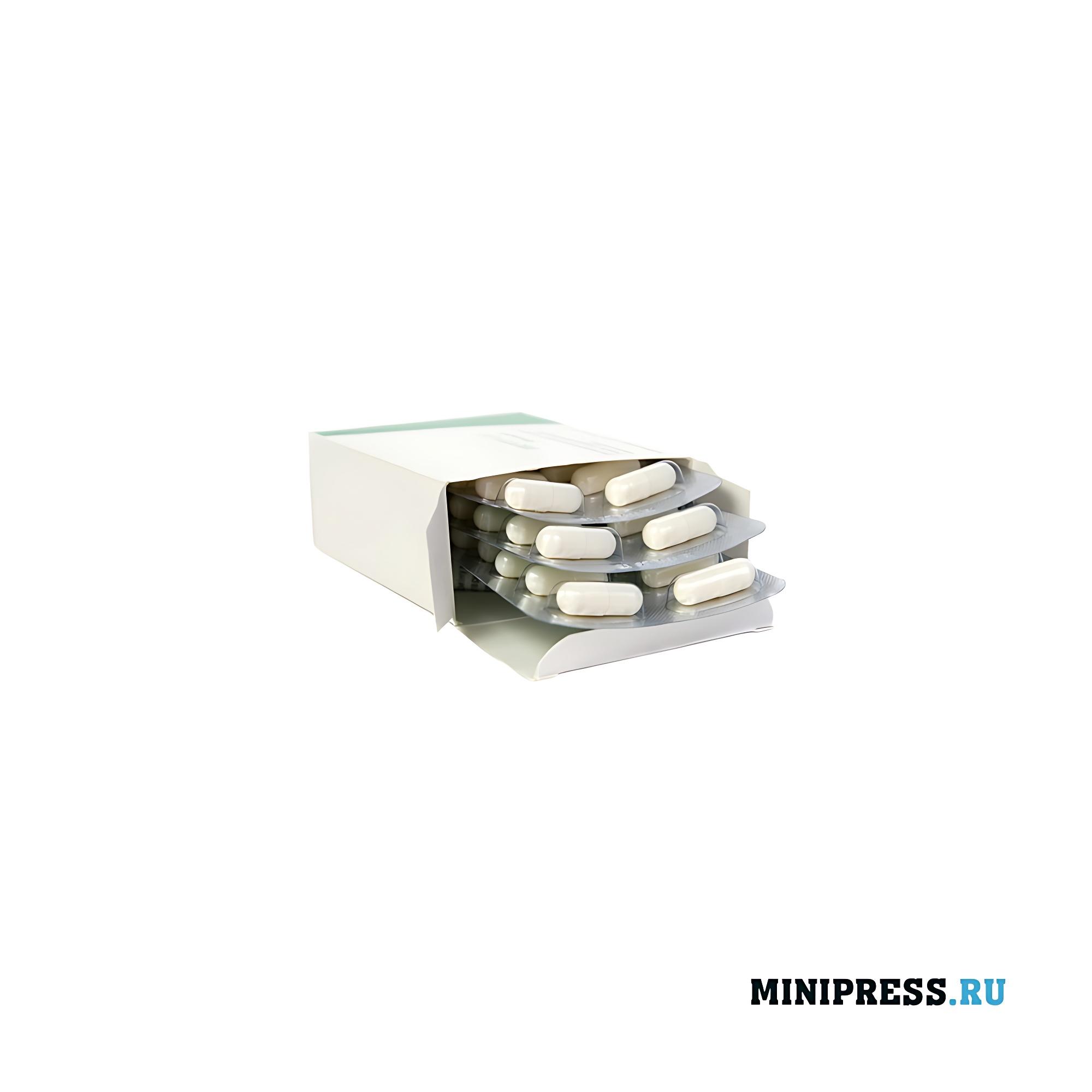 Упаковка блистеров с таблетками в картонную коробку